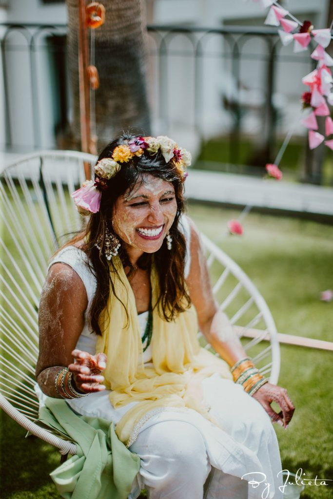 Bride covered in Turmeric at her Haldi event in Los Cabos, Mexico