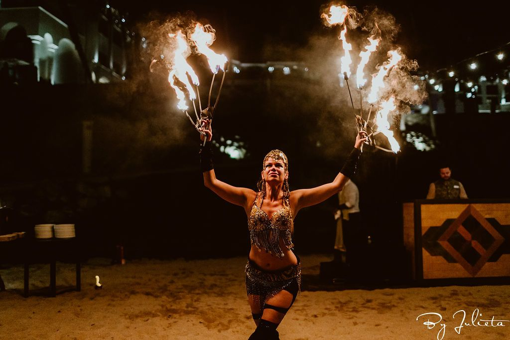 Fire dancers at the Hilton Los Cabos in Mexico, during a Destination Wedding, Planned by Jessica Wolff from Cabo Wedding Services.
