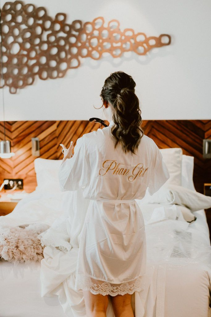 Our bride, Alexa, had a personalized robe made to say her future last name. Wedding photography was done by Ana and Jerome, wedding venue was Solaz Luxury Resorts and wedding planning was done by Cabo Wedding Services
