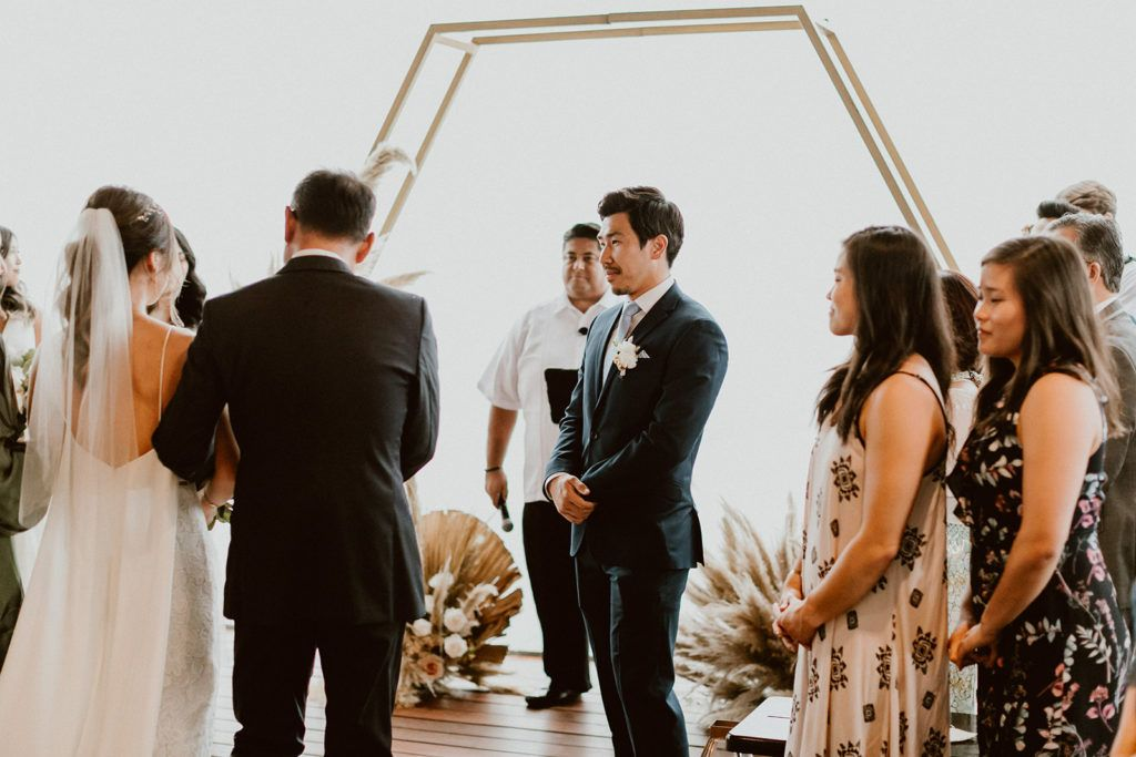 Groom waiting patient to hold his brides hand as the Ceremony begins
