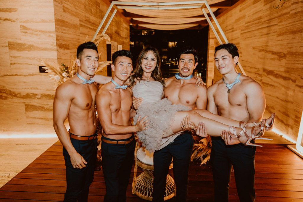 Bride with the Groomsmen during a Photo Session