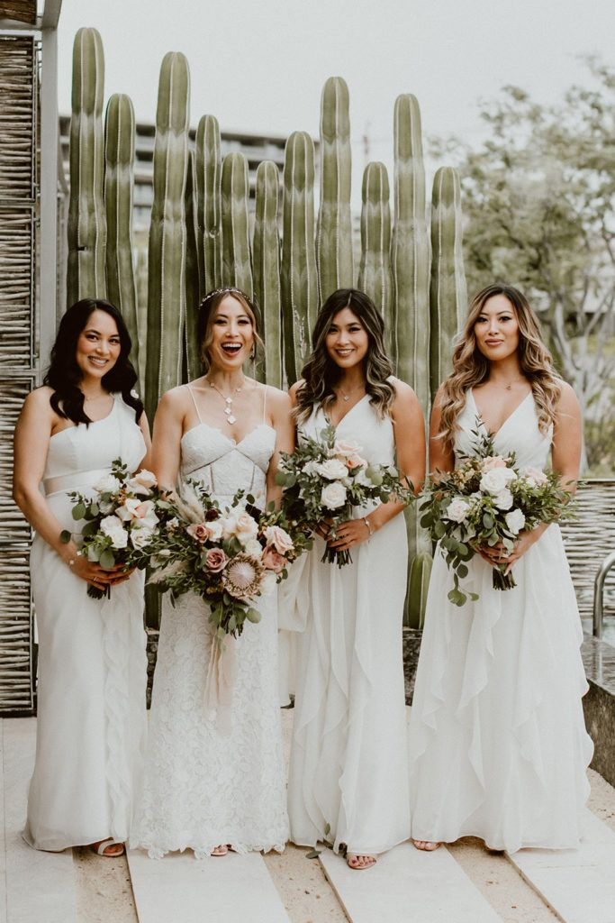 Bride holding her Bridal Bouquet with her Bridesmaids. Beautiful flower design by Let it Be. Wedding venue was at Solaz Luxury Resorts.