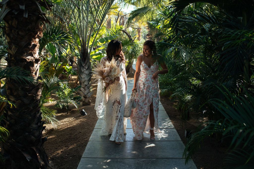 Bride arriving to her Venue with one of her besties. She got married at Wedding Venue Acre Baja in Los Cabos Mexico. Wedding planning was done by Jessica Wolff how works at Cabo Wedding Services.