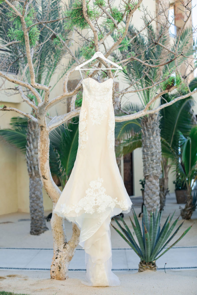 Brides Vera Wang Dress hanging up at the Waldorf Astoria, at her Destination Wedding in Los Cabos, Mexico. Wedding Planning was done by Jessica Wolff.