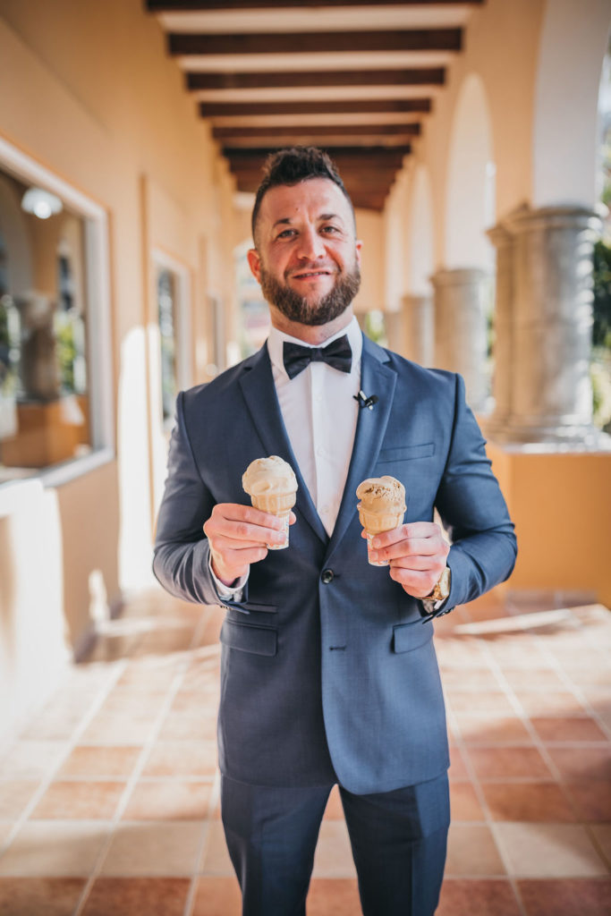 Groom holding ice cream waiting for his Bride to do the First Look at the Villa Group. This was a Destination Wedding in Los Cabos Mexico. The groom wore Armani Exchange. Wedding Planner was Jessica Wolff by Cabo Wedding Services.