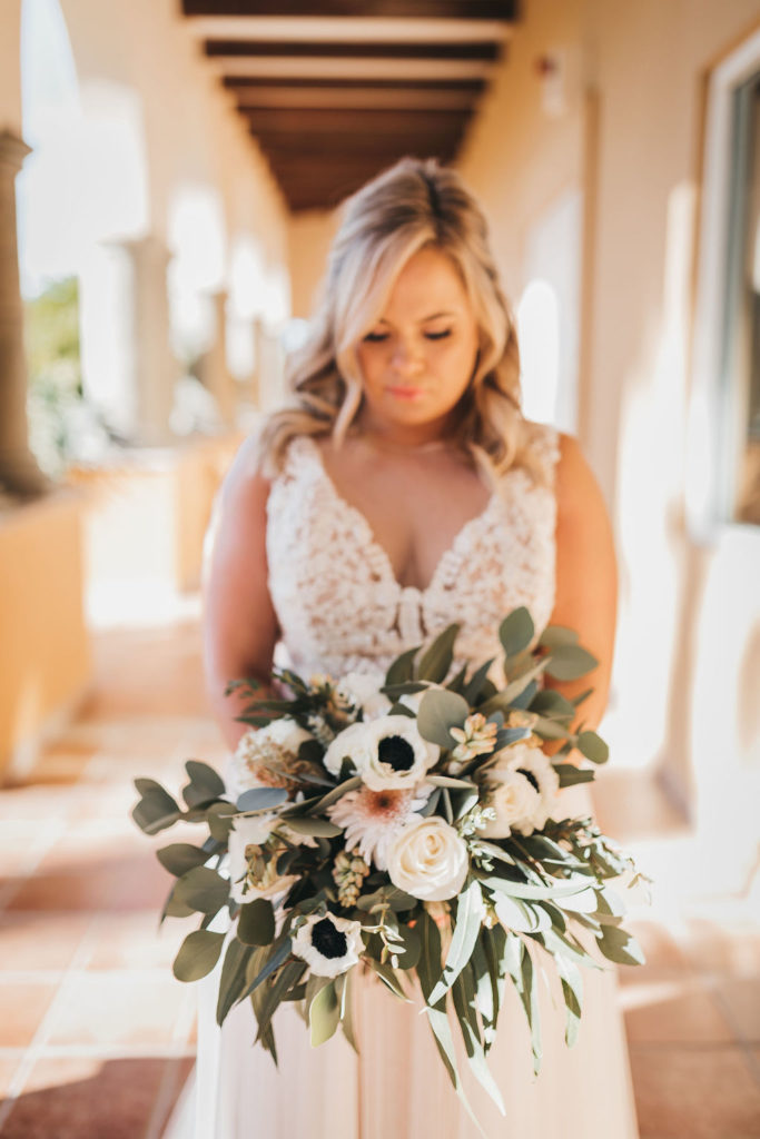 Bride holding her Bridal Bouquet prior to doing the First Look at the Villa Group. Wedding Planning was done by Jessica Wolff from Cabo Wedding Services  in Los Cabos Mexico. Destination Wedding in Cabo.