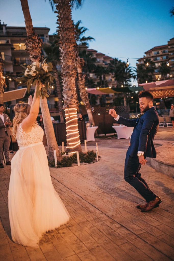 Bride and Groom Dancing on their wedding day doing their Grand Entrance