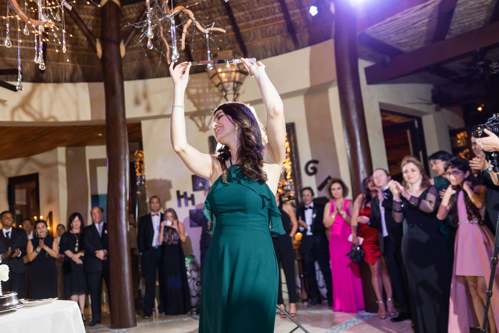 Doing the Knife dance which is a Persian Tradition. Desintation Wedding in Los Cabos Mexico. Wedding Planner Jessica Wolff from Cabo Wedding Services.