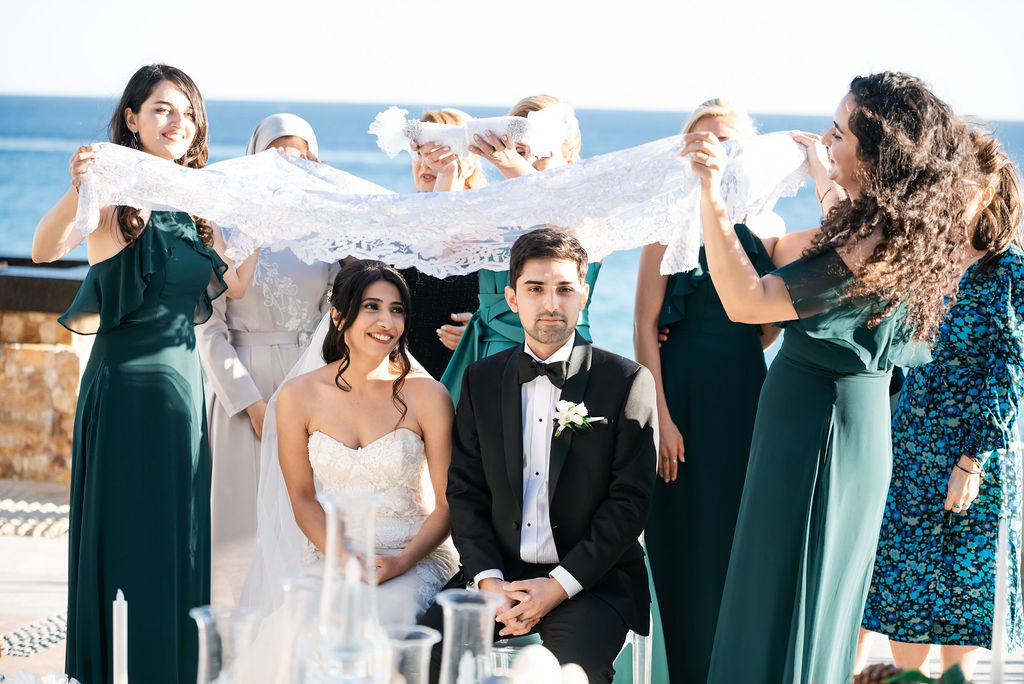 Bride and Groom getting grinned sugar over their heads for a life full of sweetness in the Persian tradition. This was a Destination Wedding done in Los Cabos Mexico at the Waldorf Astoria. The Wedding Planning was done by Jessica Wolff from Cabo Wedding Services.