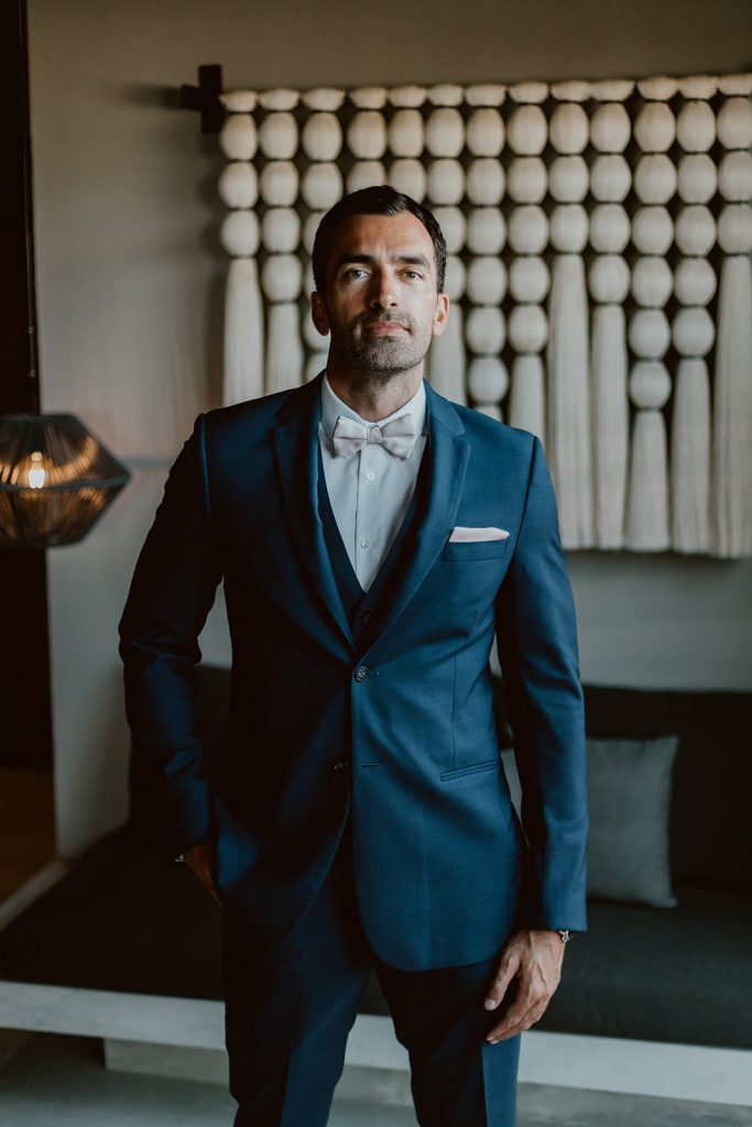 Groom getting ready right before the ceremony took place in Los Cabos Mexico. The groom as wearing a suite by Armani.