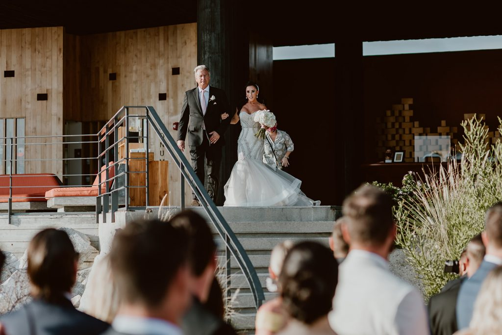 The Bride walking down to the ceremony to see her husband for the first time.