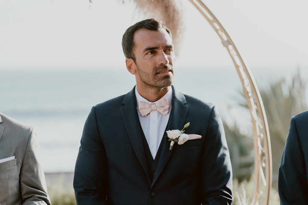 Groom standing at the alter waiting for his Bride. The wedding took place in Los Cabos Mexico, and the world renown The Cape.