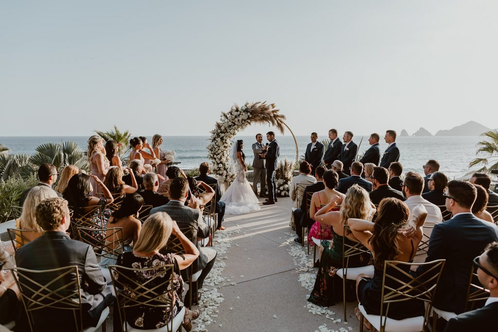 Wedding Ceremony at the Cape in Los Cabos Mexico. The bride and groom were saying their personal vows in this image. The officiant was from the US and they had a very intimate ceremony with 50 of their closest family and friends.
