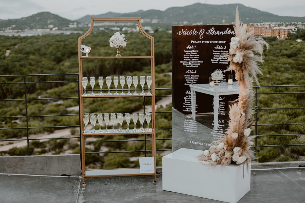 We had a champagne stand, where their guests would find their name, the table they were sitting at and a glass of champagne. this was made by The Main Event in Los Cabos Mexico. Wedding planning was done by Cabo Wedding Services.